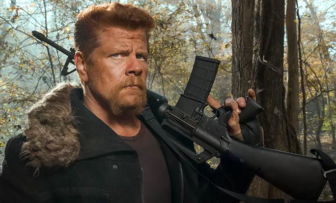 abraham segurando uma arma em imagem promocional de the walking dead