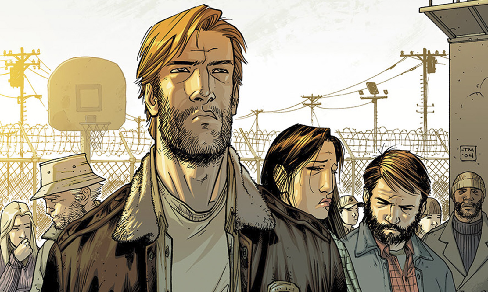 Rick e o grupo no pátio da prisão na capa da edição The Walking Dead 18
